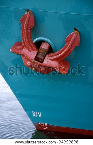 Red anchor on blue vessel. From the harbour at Aarhus, Denmark - stock photo