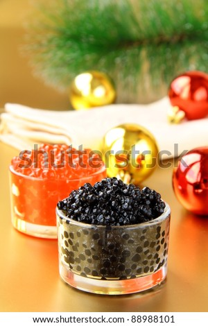 red and black caviar in glass jars - stock photo