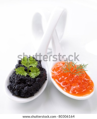 Red and black caviar on two spoons - stock photo