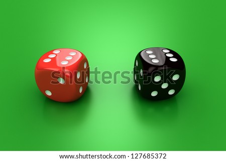 Red and black dice on the green background