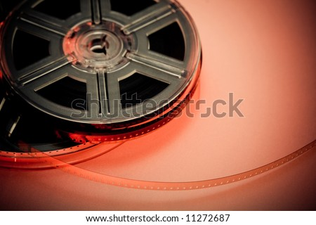 Red and black film reel concept background. Focus on film. Movie industry. - stock photo