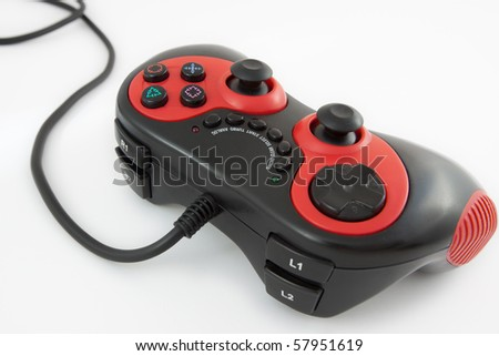 Red and black gamepad against a white background - stock photo