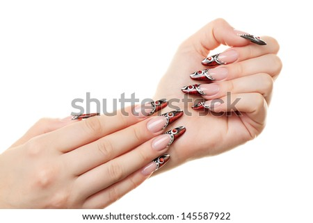 Red and black nail design. Isolated on white. - stock photo