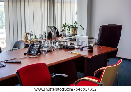 Red And Black Office Chairs Stand Around A Big Brown Wooden Table With Big  Boss Chair