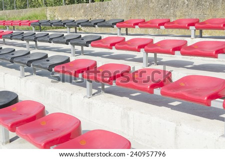 red and black stadium seats - stock photo