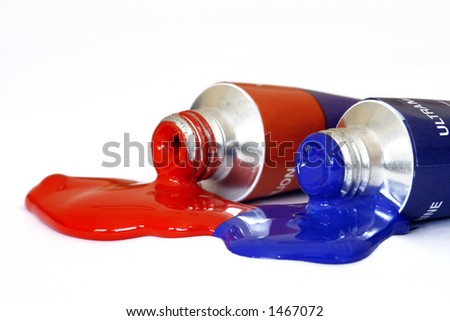 Red and blue acrylic paint pouring from a tube. Colour can be easily changed to any colour using hue/saturation in photo package - stock photo