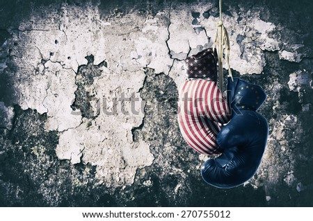 Red and blue  boxing gloves hanging on wall - stock photo