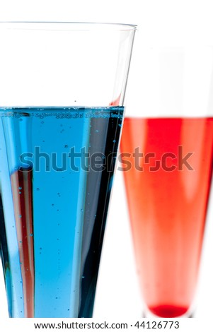 Red and Blue Champagne alcohol cocktail isolated on white background