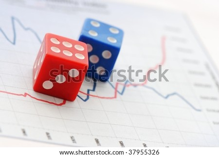 Red and Blue dices over Financial Chart - stock photo