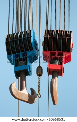 red and blue lifting hooks - stock photo