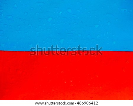 Red and blue rubber fabric with water drops