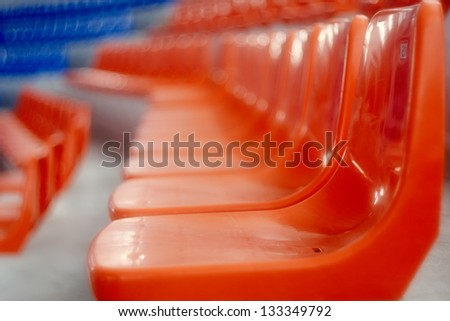 Red and blue seats in the sports hall - stock photo
