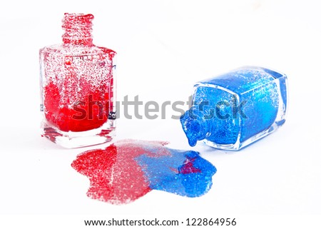 Red and blue shimmering nail polish on white background Red and blue shimmering nail polish on white background - stock photo
