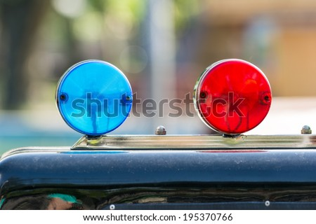 Red And Blue Sirens On Car Top - stock photo