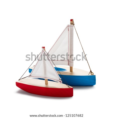 Red and blue toy sailboats, isolated on white. - stock photo