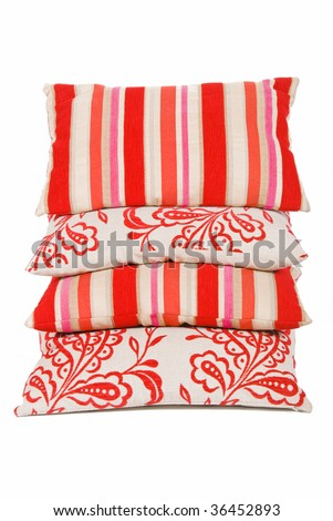 Red and cream cushion stacked - stock photo