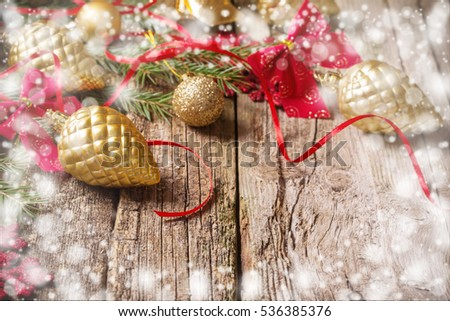 Red and golden christmas decoration on wooden background