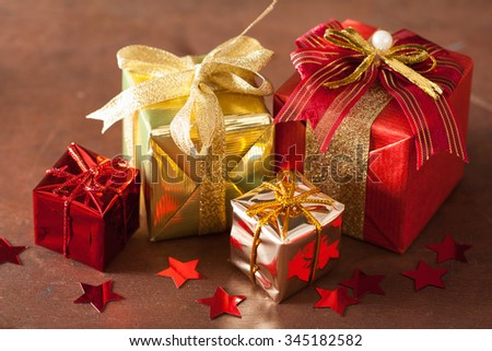 red and golden christmas gift boxes and decoration