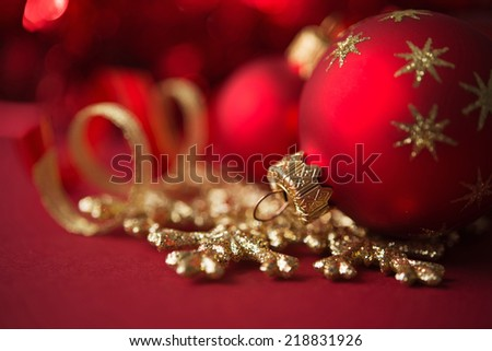Red and golden christmas ornaments on red xmas background - stock photo
