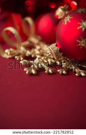 Red and golden christmas ornaments on red xmas background with copy space - stock photo