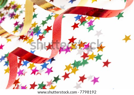 red and golden ribbons and small confetti colorful stars, party time - stock photo