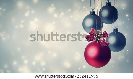 Red and gray Christmas ornaments in snowy night - stock photo