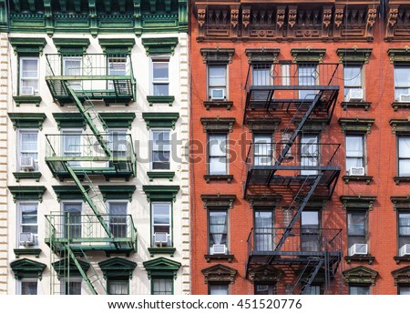 Red and Green Apartment Buildings in the East Village of Manhattan, New York City - stock photo