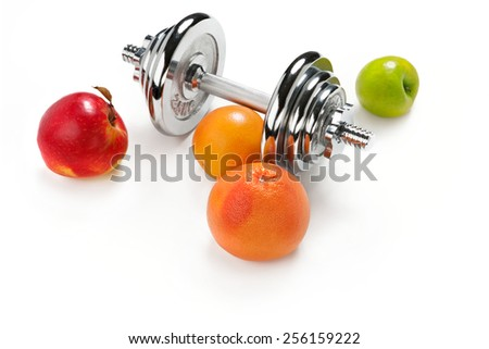 Red and green apple, orange citrus, grapefruit and dumbbell / weight training equipment on white background  - stock photo
