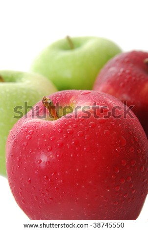 Red and green apples isolated on white. - stock photo