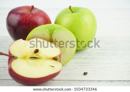 Red and green apples on wooden background texture. Healthy Food lifestyle Concept