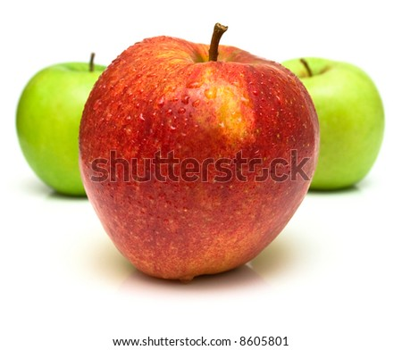 Red and green apples with water drops on the white background. Isolated. Shallow DOF. - stock photo