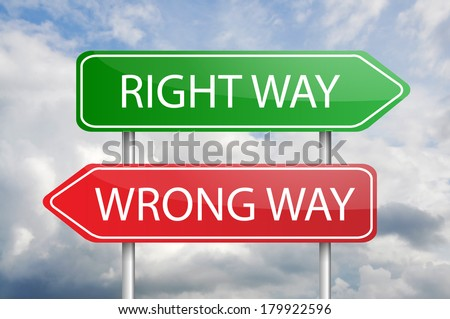 "Red and green arrow post sign ""Right Way"" and ""Wrong Way"" - stock photo"