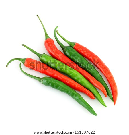 Red and green chilli peppers on white - stock photo