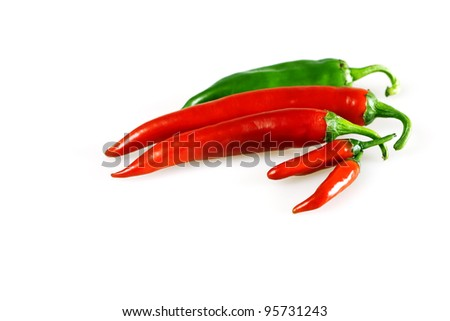 Red and green chilly pepper on a white background - stock photo