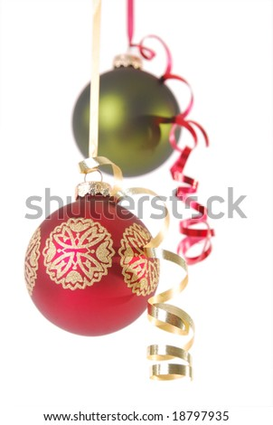 Red and green Christmas ornaments isolated on white