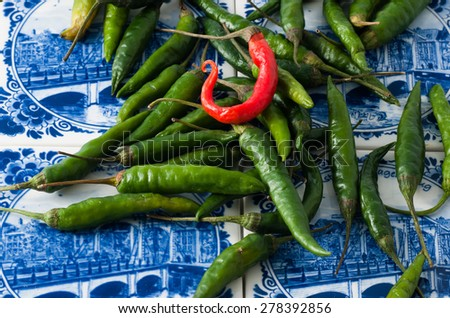 Red and green hot chili peppers - stock photo