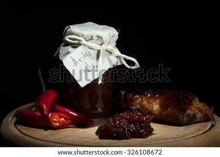 Red and green pepper jam with roast - stock photo