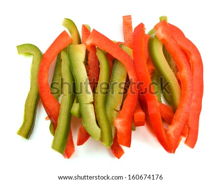 red and green peppers Bulgarian. Slicing. Cubes on white  - stock photo