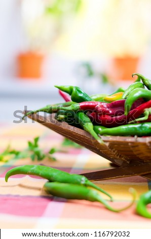 red and green peppers in a bowl