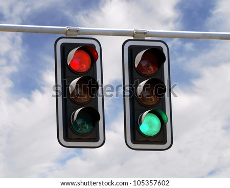 Red and green traffic lights against blue sky backgrounds - stock photo