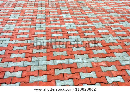 Red and grey paving tiles - stock photo