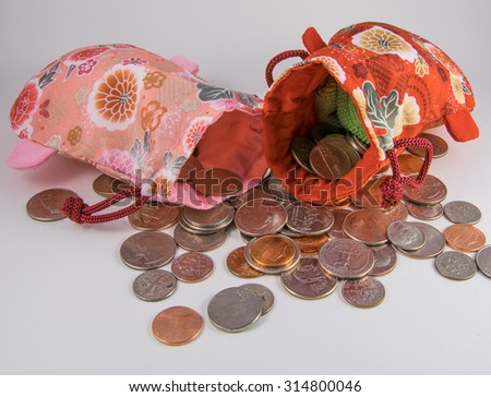 red and pink lucky money bag with coins. - stock photo