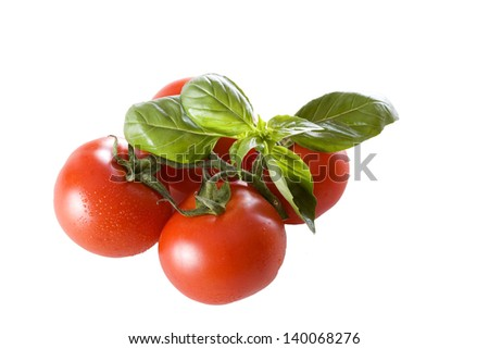 Red and ripe tomatoes with basil isolated on white background - stock photo
