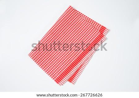 red and white checkered dishtowel on white background - stock photo