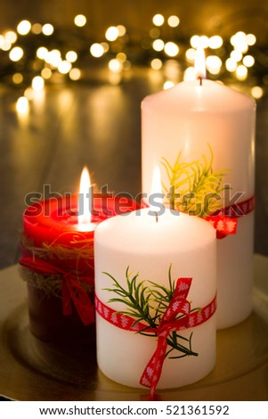 Red and white Christmas candle and Christmas ornaments