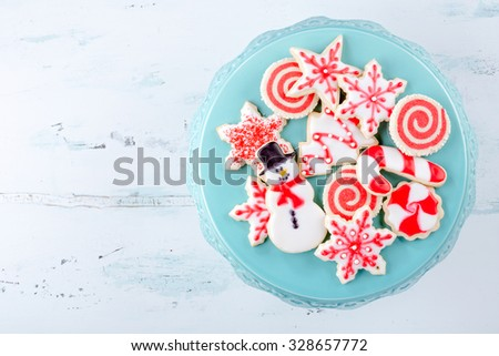 Red and White Christmas Sugar Cookies on a plate - stock photo