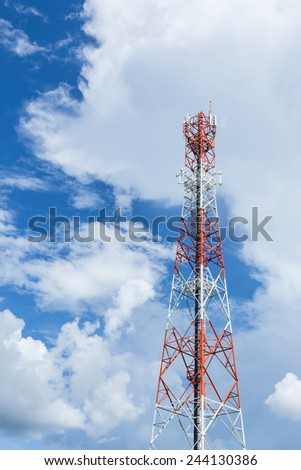red and white color antenna repeater tower on blue sky with cloud. - stock photo