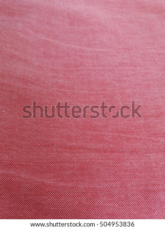 Red and white cotton fabric texture useful as a background