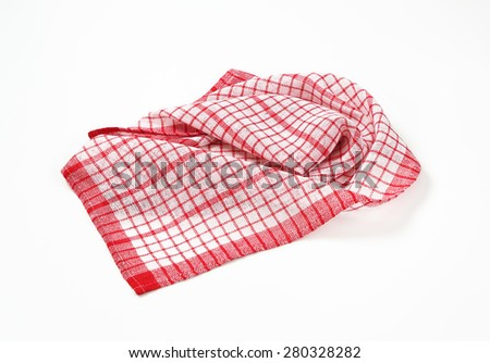 red and white crumpled dishtowel on white background