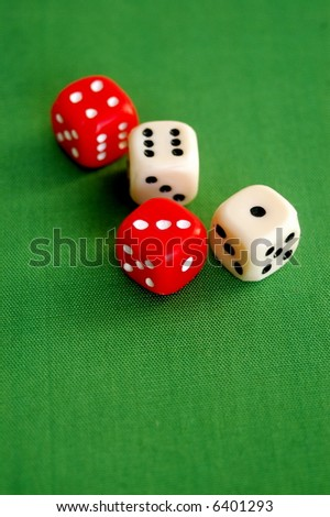 red and white dice on green background